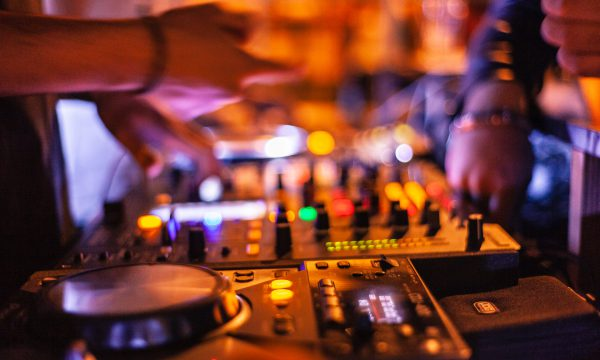 person-playing-dj-mixer-2111016